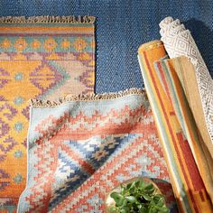 For a luxurious and eclectic look, layer bright patterned rugs over each other.