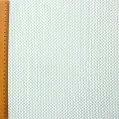 Katoen cretonne met muntgroene driehoekjes op witte achtergrond