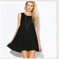 Black tunic dress Sleeveless chic swing tunic dress Light jersey knit available in Rose and Black PLEASE USE Poshmark new option you can purchase and it will give you the option to pick the size you want ( all sizes are available) BUNDLE And SAVE 10% ( sizes updated daily ) Dresses