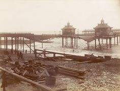 Archive photo of Brighton's West Pier on 5 December An overnight storm had destroyed the nearby Chain Pier, and the West Pier was damaged by the wreckage Brighton Sea, Brighton Rock, Brighton Sussex, Brighton England, Brighton And Hove, Royal Pavilion, Local History, Old Postcards, Vintage Travel Posters