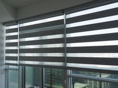 Dual Combi Vague in grey colour - a room darkening combi blind with an interesting wave pattern - shown here for condo living room.