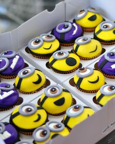 Minion cupcakes! Chocolate cake and vanilla buttercream underneath, with an adorable little Minion face on top.