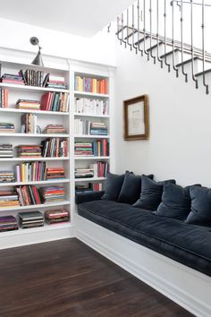 white living room--books and a comfy place to read them