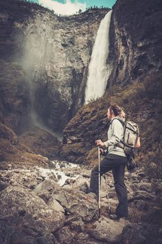 Woman hiker with backpack standing near Vettisfossen waterfall. by Nejron. Woman hiker with backpack standing near Vettisfossen waterfall. Bradley Mountain, Norway, Travel Photography, Waterfall, Backpacks, Woman, Videos, Inspiration, Biblical Inspiration