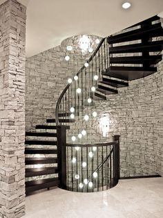 I am in love with this long #modern #light fixture that spans the length of this spiral #staircase!