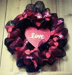 """""""Love is in the air Wreathe"""" this unique black and red pattern will just make feel loved when you receive it from your love ones.  Outstanding design for the heart!. Message the page for more information.  https://www.facebook.com/TheTreasureShop/photos/pb.238168502900624.-2207520000.1424471864./891560907561377/?type=1"""