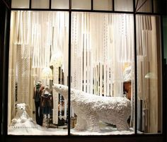 White ribbon or strips of lace to create a snowy window background or divider