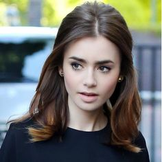 Lily Collins Hasnt Met a Beauty Look She Hasnt Tried . or Nailed: She had a slight vibe to her beauty look while in the UK. Light pink lipstick, a voluminous blowout, and a flick of eyeliner were Lily's cornerstones. Top Hairstyles, My Hairstyle, Pretty Hairstyles, Celebrity Hairstyles, Wedding Hairstyles, Classy Hairstyles Medium, Hairstyle Ideas, Middle Part Hairstyles, Stylish Hairstyles