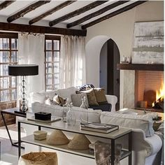 cozy up to a fireplace with this beautiful grey and latte undertone design of a living room :)