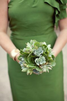 Bridesmaid bouquets made up of varying types of small green and gray succulents. Created by JL DESIGNS.