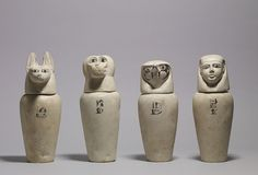 This set of canopic jars was made to contain the internal organs removed from the body during the mummification process. The four sons of the god Horus were believed to protect these organs,The jackal headed Duametef protected the stomach,the falcon headed Qebehsenuef,the intestines,the baboon headed Hapi,the lungs and the human headed Imsety,the liver. ca 900 BC (limestones with paint)