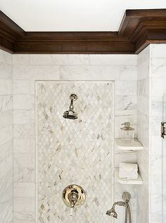 Marble Shower Tile pattern. Wide wood molding. Wood tile molding. Handheld shower, shower shelves