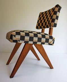 Vintage mid-century modern Pierre Jeanneret style chair.