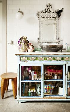 Bohemian - A vintage cabinet in a bathroom with white subway tile
