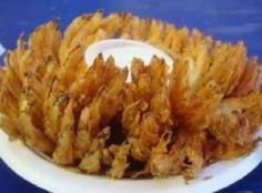 """(I love """"blooming onions"""" and this is a low fat version because it is baked, not deep fried. (I love """"blooming onions"""" and this is a low fat version because it is baked, not deep fried. Vegetable Appetizers, Vegetable Recipes, Onion Blossom Recipe, Baked Blooming Onion, Grilled Blooming Onion Recipe, Baked Onions, Tailgating Recipes, Onion Recipes, Appetizer Recipes"""