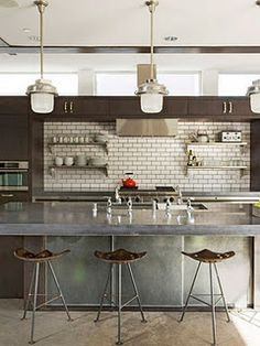 Great kitchen. Especially like the mixture of warm wood cabinetry with industrial accents and modern, clean lines.