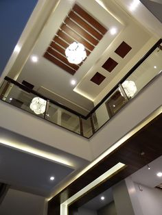 Double Height Lobby ceiling: Corridor & hallway by Hasta architects Down Ceiling Design, Drawing Room Ceiling Design, Wooden Ceiling Design, Gypsum Ceiling Design, House Ceiling Design, Roof Ceiling, Ceiling Design Living Room, Bedroom False Ceiling Design, False Ceiling Living Room