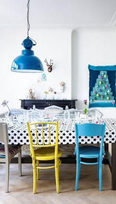 I love the brightly painted chairs at this dining table!