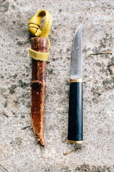 Knife and it's leather sheaf by Deirdre Malfatto #stocksy #realstock