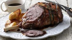 The ultimate roast dinner for Easter or spring, this roast leg of lamb is served with a rich red wine gravy and garlic butter. Garlic Recipes, Lamb Recipes, Roast Recipes, Uk Recipes, Irish Recipes, Steak Recipes, Dinner Recipes, Bbc Good Food Recipes, Kitchens