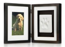 "Pet Memorial Desk Frame (""Pear Head Brand) - $31.20 - Description: This hand finished wood frame comes with everything you need to make a lasting impression of your pet's pawprint. our clay impression material is simple to use. there is no mixing or baking involved and it air-dries overnight. all materials are 100-percent pet safe. this keepsake frame is great to use for any small pet and sits perfectly on a desk or tabletop. - From Puppies Puppies Store on Amazon"