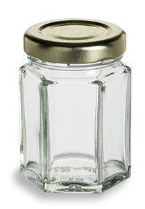 Specialty Bottle - 2 oz (55 ml) Hexagon Glass Jar with Gold Lid, $0.68 (http://www.specialtybottle.com/glass-jars/hexagon/2oz-hex2)