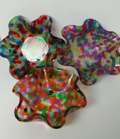 Pony beads melted in a cake pan and then melted again over a bowl shaped pan. Created by Sara Landin.