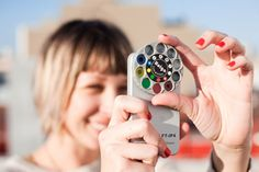 """It's a rotating disk equipped with 9 different lenses for your iPhone! Just fit the case that it comes on over the back of your phone, and you're set for hours of phoneography fun.  It's like having 9 toy cameras all in one: lenses for dreamy vignettes, vibrant red and green color lenses, multi-image lenses for Spidey-vision (double, triple, and quadruple images), a macro lens for beautiful close-up detail and red, yellow, and blue filters with clear centers for framing your subjects!"" $30"