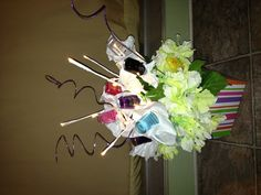A cute gift for a girl friend. $6 Total The nail polish was BOGO 6 for $3 Styrofoam (I used a pool noodle)$1 Pot, after Easter sale.           $2  The rest of the items I already had.  Use a long floral stick tissue paper and a rubber band to secure  the nail polish.   A ribbon hides the rubber band.  Add lights (After Christmas special) & other items for quirkiness and to fill in the gaps.   This one only took 10 minutes. Imagine what you could do with more time.