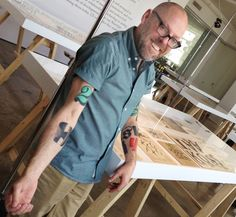 """My tattoos are always a point of interest with type crowds,"" says Dan Rhatigan, who said he got his first tattoo, the swashy 'R' of an ersatz family crest he designed, in 1998. ""After staring at that 'R' for months, I realized that my love of type is timeless. So I started adding shapes I loved from different typefaces, working with different tattoo artists who appreciate the idea enough to carefully reproduce the artwork I supply."" #tattoos #designer #type #lettering"