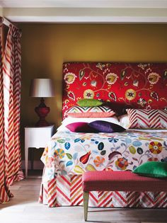 Add a splash of colour to your bedroom! These Mardi Gras-inspired covers jazz up this room against the warm mustard walls. Match your curtain and bedding accessories for coherence in a loud enviroment.