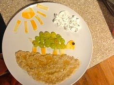 Turtle: grapes & cheese, Ground: plain oatmeal with honey drizzled over top, Sun: cheese, Cloud: whipped cream, Eye: raisin