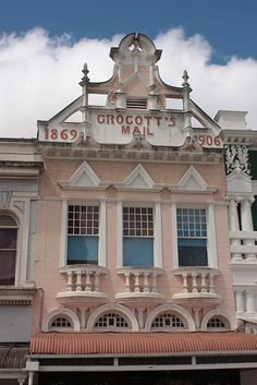 This image of the facade of Grocott's Mail building, was taken in the High Street, Grahamstown. This building is declared a National Monument, now called heritage sites. The High Street has many such well preserved heritage sites. Footprints, Paladin, Beautiful Buildings, Rhodes, Heritage Site, Beautiful World, South Africa, Facade, Birth