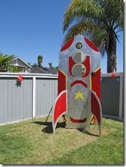 Plywood Rocket Ship for the Space Cowboy Birthday Party. Cost about 40 bucks to make.