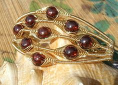 Blood red cubic zirconia wire wrapped handmade cuff by catinalife, $58.00
