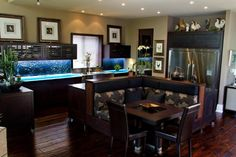 """Solid 1"""" wenge doors featuring LED underlit glass counter top and back splash."""