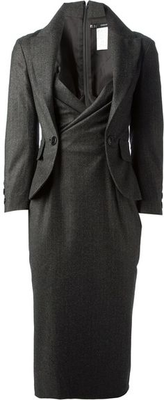 looks like you  could  wear it with out  without the  blazer- might be that it buttons to the dress??