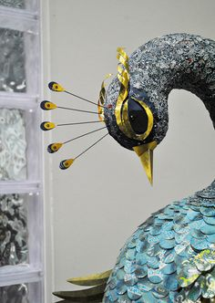 Life size peacock created using hand-cut Chiyogami papers, gold foil and Swarovski crystals.