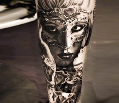 Carnival mask tattoo by Michael Taguet
