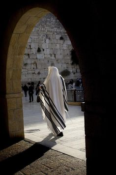 A man dressed in very Jesus-like garb at the Western Wall - Jerusalem, Israel. - Explore the World with Travel Nerd Nici, one Country at a Time. http://TravelNerdNici.com