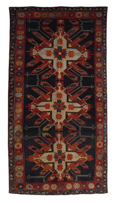 """Eagle Kazak throw rug, ca. 1910, with 3 medallions on a blue field with red and blue borders, 8'8"""" x 4'7""""."""