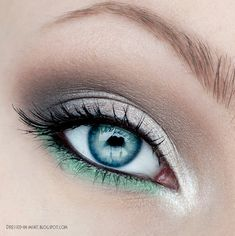 "Silver and Mint Green Smokey Eye ~ recreate w/ MAC ""Phloof""(frosted off white) on inner eye corner to mid lid, ""Satin Taupe""(mushroom w/ silver shimmer) from outer lid to crease and a pop of MAC Aquavert Shadow in ""Mint"" on lower lash line"