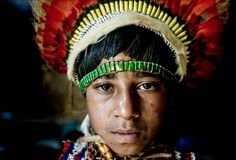 Vegu, a member of the Nagamiufa tribe, in the eastern highlands of Papua New Guinea wearing traditional 'bilas'. Her grandfather recieves a small living allowance from the government for his work preserving traditional costumes of tribal groups in the highlands.