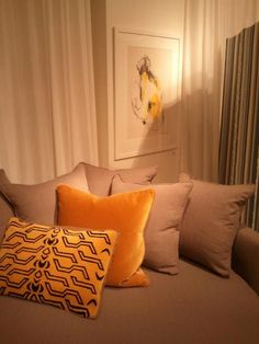 Love how the colors from the artwork and the pillows compliment each other.     — at Mitchell Gold + Bob Williams DC.