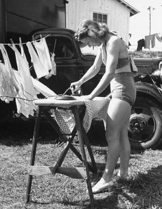 1940s housewife ironing outside. (LOL that would definitely be my mother!)