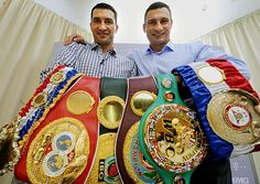 Wladimir and Vitali Klitschko. two very motivated brothers. look at all the belts.