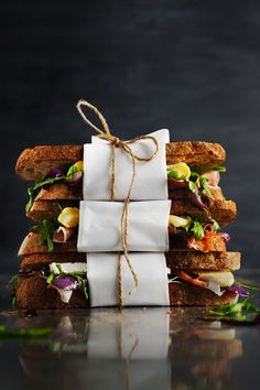 Brie, Prosciutto, Caramelized Onion and Arugula Sandwich.