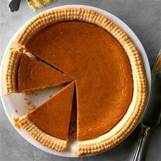 Spiced Eggnog Pumpkin Pie Recipe -With its 10-minute prep time and lovely blend of mild eggnog flavor and spices, this is a busy hostess' dream dessert! It's a staple for Thanksgiving and Christmas. In fact, my grown kids request it whenever they come to visit. —Patti Leake, Columbia, Missouri