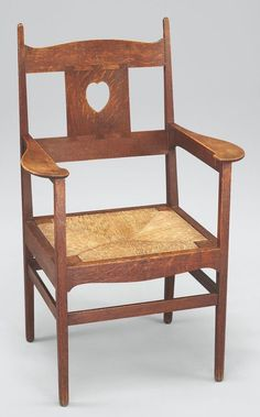 Charles Francis Annesley Voysey, oak armchair, 1902, dovetailed splat with pierced heart, rush seat