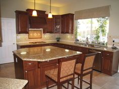 new caledonia granite with cherry cabinets | ... kitchen-new kitchen - classy cherry wood cabinets and granite counter